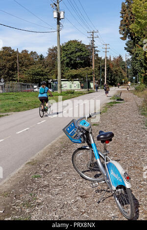 A Mobi Bike Share bicycle parked on the Arbutus Greenway corridor in Vancouver, BC, Canada - Stock Image