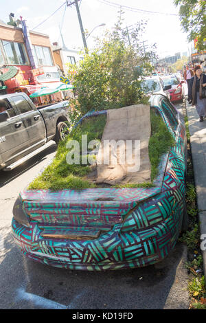 The Garden Car parked on Augusta Street in Kensington Market in downtown Toronto, Ontayario, Canada - Stock Image