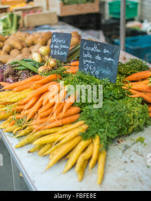 Carrots For Sale At Market Stall - Stock Image
