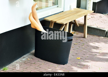 Mannequin legs in the dust bin of the pedicure - Stock Image