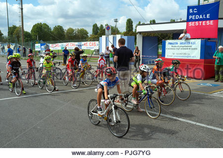 Children's bicycle race - moments before the start the riders take position before the off . Sesto San Giovanni, Milan, Italy. - Stock Image