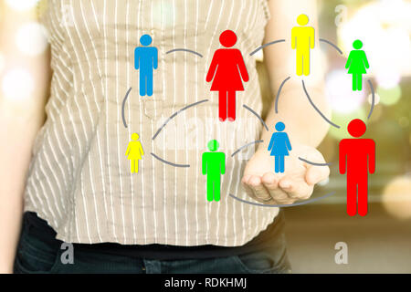 Woman holding illustration of colorful people icons connected to each other. Social Media concept. - Stock Image