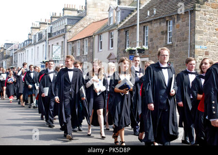 St Andrews University graduates on their academic procession along North Street towards St Salvator's Quad to meet their guests - Stock Image