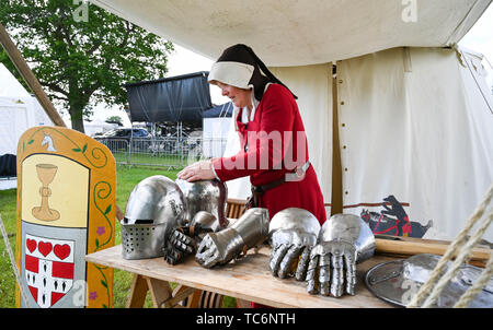 Ardingly Sussex UK 6th June 2019 - Time to clean the armour on the first day of the South of England Show held at the Ardingly Showground in Sussex. The annual agricultural show highlights the best in British farming and produce and attracts thousands of visitors over three days . Credit : Simon Dack / Alamy Live News - Stock Image