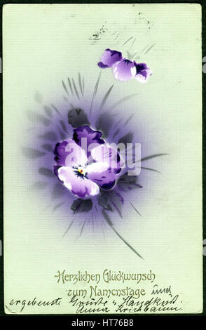 A greeting postcard printed in Austria, shows a beautiful bouquet of flowers. The inscription in German: Happy Name - Stock Image