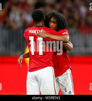 Optus Stadium, Burswood, Perth, W Australia. 17th July 2019. Manchester United versus Leeds United; pre-season tour; Tahith Chong of Manchester United congratulates Anthony Martial after he scored from a penalty in the 69th minute to make the score 4-0 Credit: Action Plus Sports Images/Alamy Live News - Stock Image