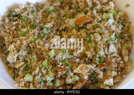 Close up of raw stuffing mixture for Thanksgiving turkey, a recipe of bread crumbs, celery, onion, parsley, sage and butter  Close up, raw, stuffing,  - Stock Image