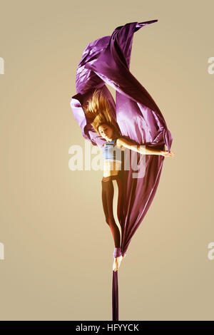 Aerial acrobatics acrobat girl isolated - Stock Image
