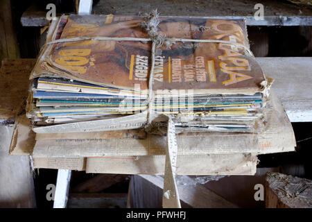 bundle of old dusty nok lapja ladies fashion magazine from the 1990s left in a barn zala county hungary - Stock Image