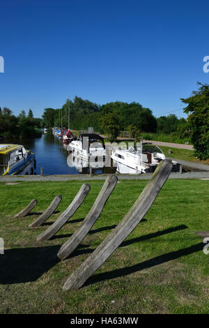 Rockland Staithe situated off the River Yare on the Norfolk Broads. In the foreground the bones of an old wherry. - Stock Image