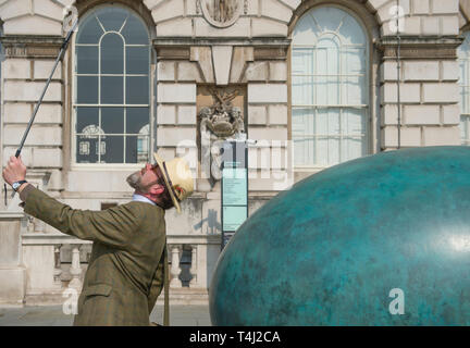 London, UK. 17th April, 2019. A giant bronze egg sculpture, 'Oeuvre', by Gavin Turk, is unveiled at Somerset House. The bronze egg is intended as a starting point and inspiration for photographers around the world to Collaborate with Gavin on an ambitious public installation for Photo London, titled 'Gavin Turk - Portrait of an Egg'. All that is required to take part is a digital photographic device with which to record their own 'Portrait of an Egg. Credit: Malcolm Park/Alamy Live News. - Stock Image