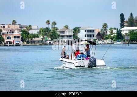 St. Saint Petersburg Florida Bay Pines War Veterans Memorial Park view Boca Ciega Bay outboard motorboat boat - Stock Image