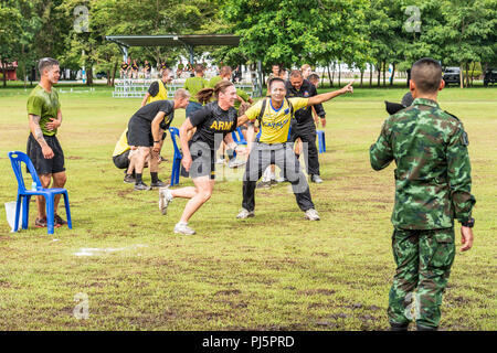 Idaho Army National Guard Maj. Jamie Jarolimek participates in a relay game as part of sports day Aug. 24 during Hanuman Guardian 2018 at the Royal Thai Army's Cavalry Center in the Saraburi province. Hanuman Guardian, Aug. 20 – 30, demonstrates the U.S. and Kingdom of Thailand's commitment to its longstanding alliance while also strengthening the capabilities of both forces. - Stock Image