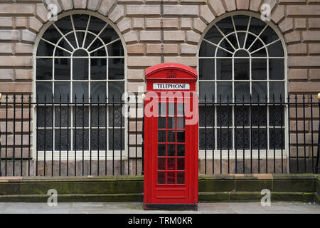 Building detail in the business centre of Liverpool.UK. BT Red phonebox - Stock Image
