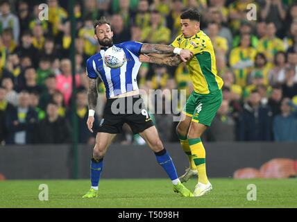 Sheffield Wednesday's Steven Fletcher (left) and Norwich City's Ben Godfrey battle for the ball during the Sky Bet Championship match at Carrow Road, Norwich. - Stock Image