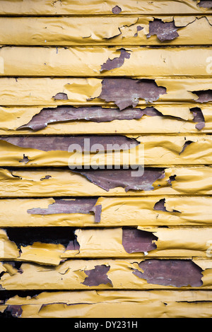 Picture of a wall of a buildning damaged by fire, where the paint has melted. - Stock Image