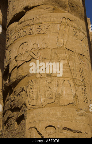 Stone Column in the Temple of Karnak, Luxor, Egypt, Decorated with Hieroglyphics and Pictures of the Ancient Egyptian - Stock Image