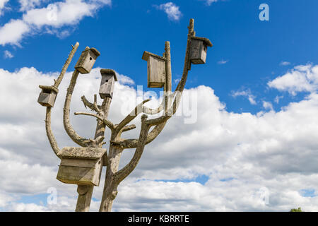 Heap of boxes for birds to nest in them in summer - Stock Image