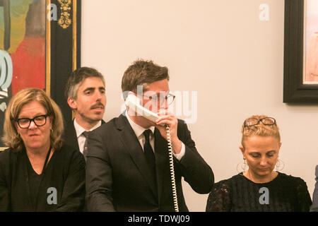 London UK. 19th June 2019. Sotheby's staff taking bids on the phone on behalf of clients at the Impressionist & Modern Art Evening Auction  at Sotheby's London Credit: amer ghazzal/Alamy Live News - Stock Image