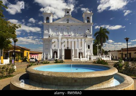 Front View of Iglesia Santa Lucia, a Colonial White Cathedral on Central Plaza in Latin American Town Suchitoto, El Salvador - Stock Image