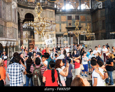 Crowds of tourists in the famous, historic Hagia Sofia (Ayasofya), first a church, then a mosque, now a museum. - Stock Image