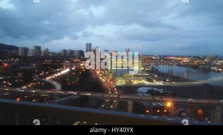 High Angle View Of Illuminated Cityscape Against Sky At Dusk - Stock Image