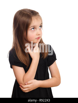 Cute young girl with finger on mouth thinking, pondering or deep in thought - Stock Image