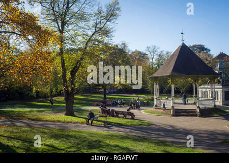 People enjoy some late Autumn sunshine in Forbury Gardens, Reading, Berkshire - Stock Image