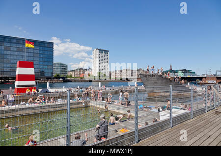 Copenhagen, Denmark. 2nd June, 2018. On the second day of the harbour bath season that began yesterday thousands of Copenhageners, tourists and visitors enjoy another warm and sunny summer day of the long-lasting and early heat wave that made May the sunniest and warmest on record in Denmark, here in the Islands Brygge Harbour Bath in the inner harbour. In Denmark a summer day is any day on which temperatures top 25 degrees Celsius - until now there have been 19 of these - actually, on many days temperatures have been close to 30 degrees. Credit: Niels Quist / Alamy Live News. - Stock Image
