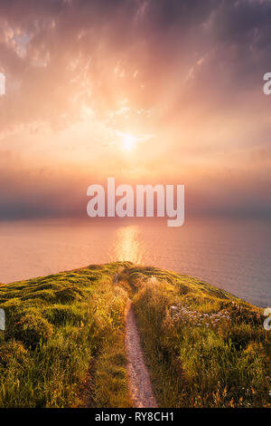 path near the sea at dreamy sunset - Stock Image