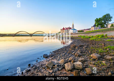 Rocks on the side of Volga river on sunrise in Rybinsk, Russia - Stock Image