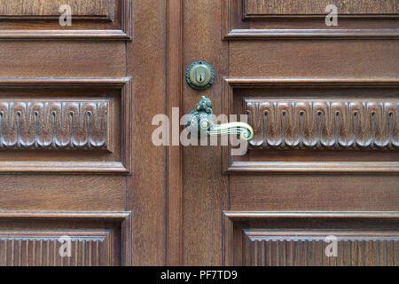 Beautiful line of wooden doors with the door handle - Stock Image