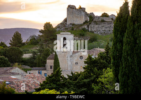 View on traditional medieval houses and castle ruines in Provence during sunrise, South of France, vacation and tourist destination - Stock Image