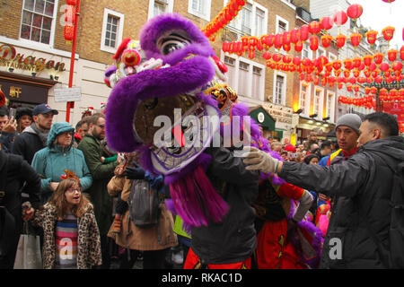 London, UK. 10th February 2019.  Performers are lead along Gerrard Street as hundreds of Londoners attend the Chinese New Year Celebration in Chinatown, central London to urse in the Year of the Pig. The event was organised by the London Chinatown Chinese Association (LCCA). Photo by David Mbiyu/ Alamy Live News Credit: david mbiyu/Alamy Live News - Stock Image