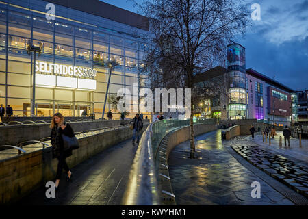 Designer department stores Selfridges & Co and Harvey Nichols  at Exchange Square  Manchester city centre - Stock Image
