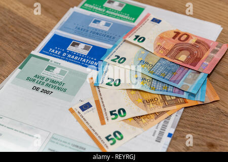 Paris, France - November 15, 2018 : The various French taxes return and banknotes in euros - Stock Image
