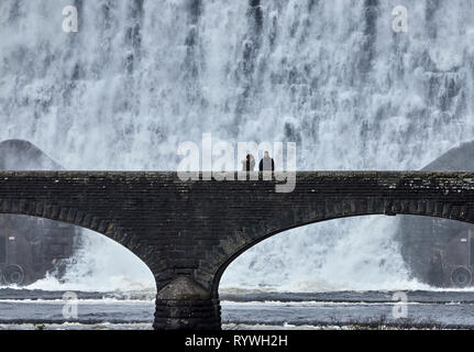Caban Coch Dam with two people Elan Valley Powys Wales UK - Stock Image