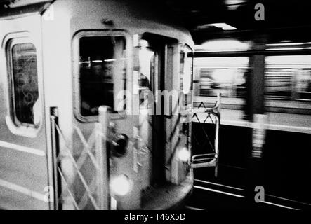 New York City Subway Train is speeding down the track, USA - Stock Image