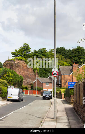 The Old Quarry, a road in Liverpool with houses built in an old red sandstone quarry. Stone from this area was used to construct Liverpool cathedral. - Stock Image