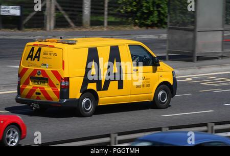 AA breakdown van travelling along a road. - Stock Image