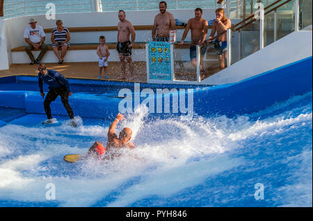 Young man crashes while flow surfing / flowriding aboard the Independence of the seas cruise ship - Stock Image