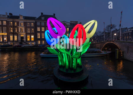 Amsterdam,canal Herengracht with lights and artwork Bunch of Tulips by Peter Koros during Amsterdam Light Festival in winter. - Stock Image