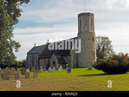 The picturesque  medieval church at West Somerton, Norfolk is flint built and has an unusual round tower rarely found outside East Anglia. - Stock Image