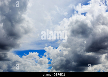 Summer storm clouds forming up overhead - Midwest United States. - Stock Image