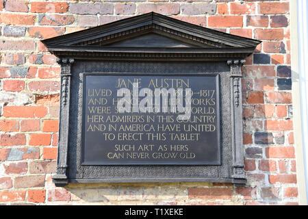 Plaque/tablet outside Jane Austen's House, Chawton, near Alton, Hampshire, UK. Sunday 24 February 2019. - Stock Image