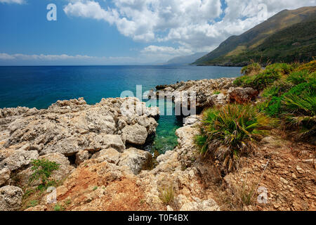 Seaside nature park with coastline cliffs, rare plants, museums, picnic areas & trails to the sea. Zingaro Nature Reserve in Sicily - Stock Image