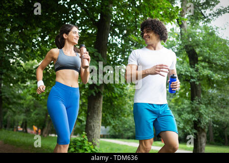 Beautiful couple jogging in nature living healthy - Stock Image
