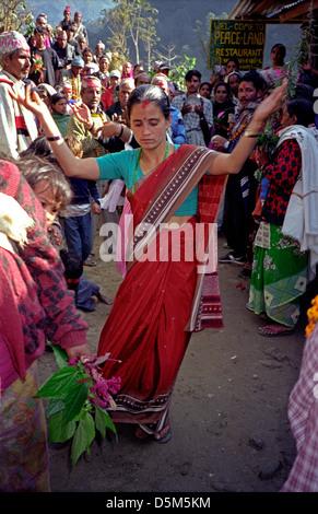 Woman Lady dancer at Hindu celebration after seven day period of prayer near Naya Pul Nepal Himalayas - Stock Image