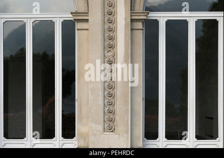 door windows of an Italian villa in classic style - Stock Image