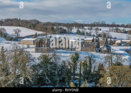 Egglestone Abbey, Barnard Castle, Teesdale in a snowy landscape and winter sunshine - Stock Image
